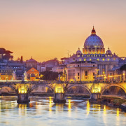 View on Tiber and St. Peter's cathedral at night, Rome