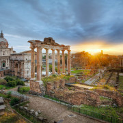 After a morning of shooting photos in Rome, we ended up at the Roman Forum at sunrise. Roman Forum, is the old center of ancient Rome. Ceasars held speaches, the triumphs of the Roman Empire were celebrated here. It was the main street of Ancient Rome. It's an incredible interesting place. However, we were too early, to get in, and we had seen it already, now we just shot it. Even if we didn't plan for it, we got a sunrise, with the Sun rising exactly above the Colosseum.--Jacob Surlandwww.caughtinpixels.comArt sale as limited prints. Photo by Jacob Surland,  Licensed Creative Commons non-commercial v4.0.  No Derivative Work. Protected by Pixsy.com.